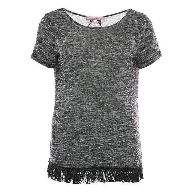 Looking for a special piece to upgrade your wardrobe? How about this fringed shirt?
