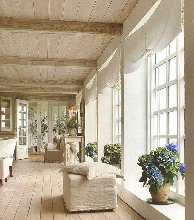 Belgian style with natural oak floors, Belgian linen, wood plank ceilings and beams, and tons of natural light.