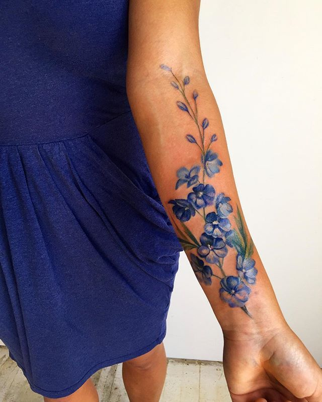 This is on  @madmcferrin . She had a few laser sessions to remove an old tattoo...and we disguised what was left of it, with some blue delphinium.