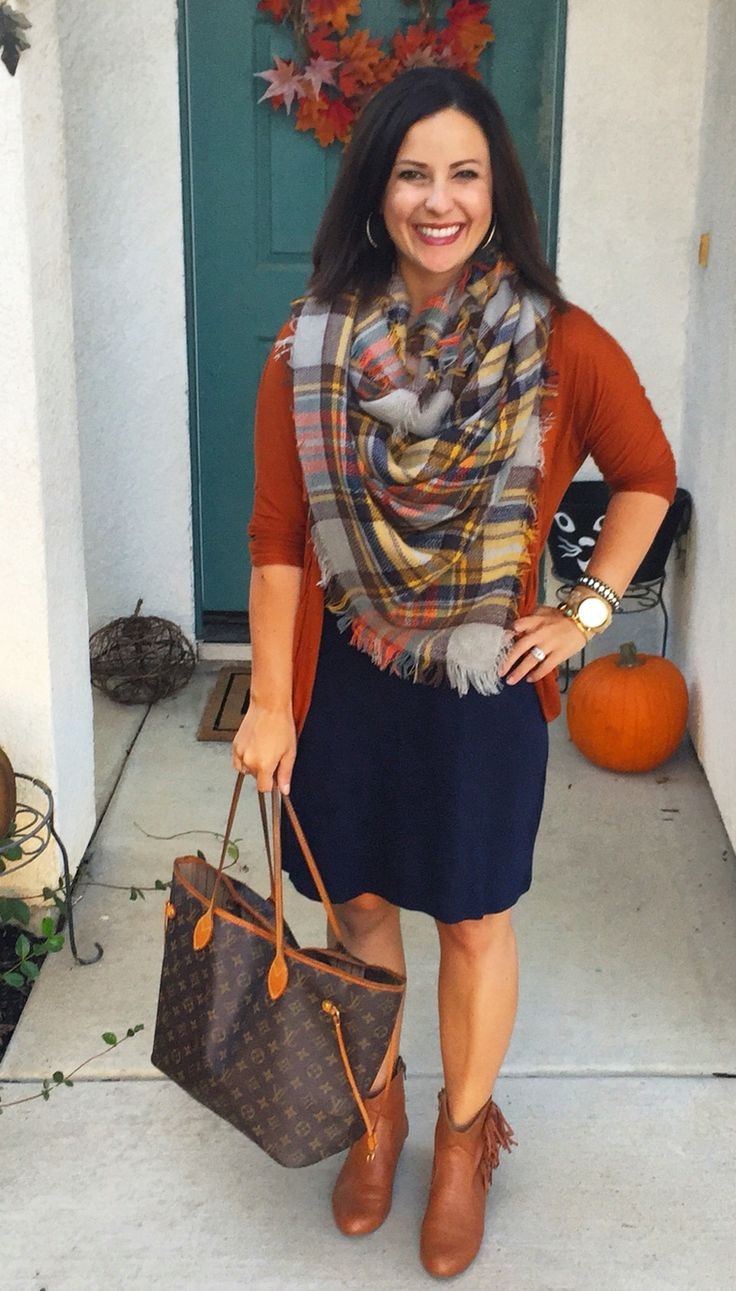 Fall style, teacher ootd, outfit ideas. Navy dress, rust cardigan, orange plaid blanket scarf, fringe booties.