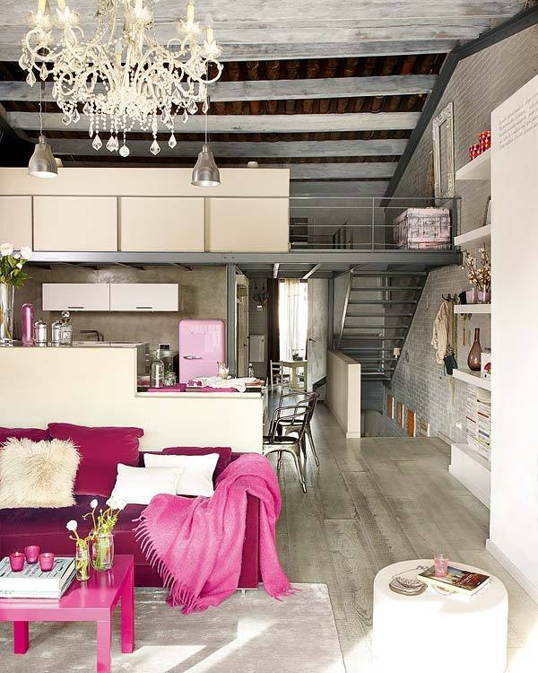 greige weathered rafters, steel industrial loft, with shabby chic changelier and fuchsia accents , loft, livingroom, great room, decorating {via Curbly by DIY Maven, Photo: Ideas to Steal}
