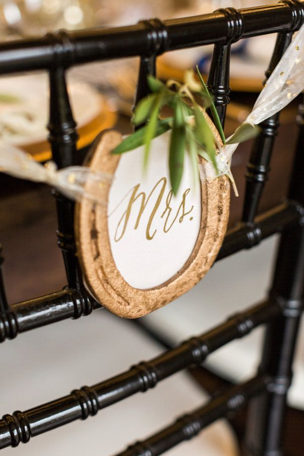 Rustic gold horseshoe wedding chair ribbon: http://www.stylemepretty.com/georgia-weddings/douglasville/2016/09/12/southern-horse-stable-wedding/ Photography: Rustic White - http://www.rusticwhite.com/