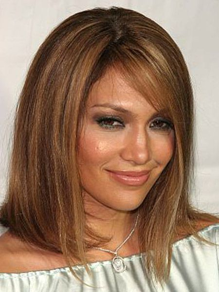 LOVE the color and style... Hmm... Now I want to cut my hair again. :)