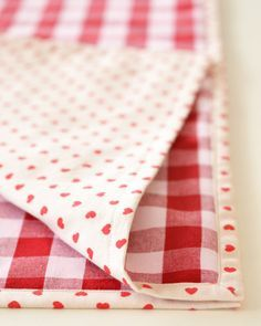 You can always use another set of placemats, right? I absolutely love these red heart and checkered ones. Reversible to fit the occasion!
