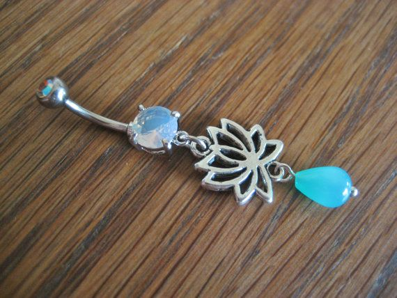 """From Azeetadesigns, my favorite piercing jewelry right now.  I even have a tan """"line"""" around where the lotus is from wearing while sunning."""