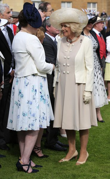 Camilla, Duchess of Cornwall (right) attends a garden party at Buckingham Palace on May 19, 2016 in London, England.