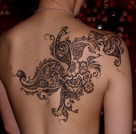 http://tattoomagz.com/pretty-lace-tattoos/flower-ornaments-lace-tattoo/
