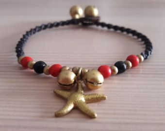 Welcome to Bohemian Style Thai Jewellery. You are looking at a gorgeous star charm bracelet, featuring striking black and red howlite stones. The bracelet fastens at 2 lengths with a loop and ball fastening. The remainder of the bracelet is skillfully woven black waxed cotton macrame, which is strong, durable and long-lasting.   www.bohemianstyleshop.etsy.com
