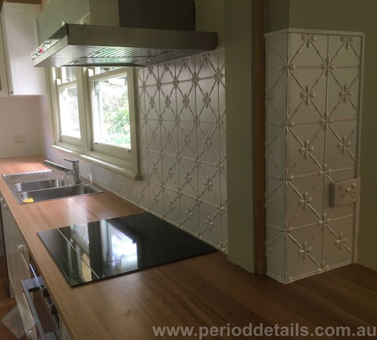 The clover pattern in Dulux Duralloy White Satin powdercoat looks fantastic in this kitchen. We just love the way our installer, David, has bent the panel around the corner. The open edges have been finished off with wallboard capping, powdercoated to match. We can supply the materials only or supply and install (Melbourne Suburbs only). Find out more at www.perioddetails.com.au