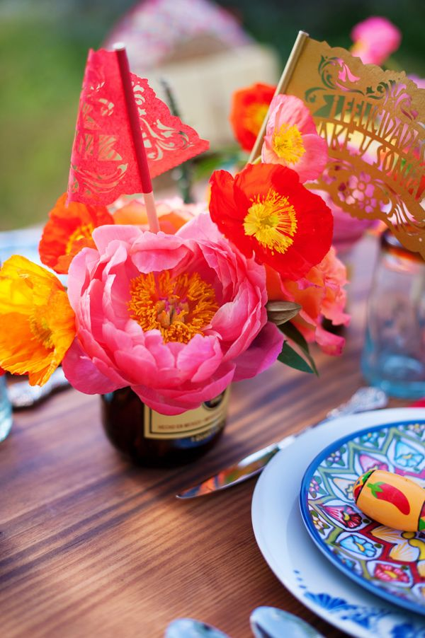 beautiful colorful latin inspired centerpiece with flowers