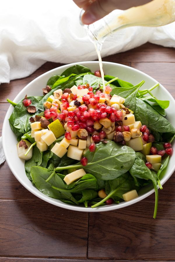 Pear, Gouda & Hazelnut Spinach Salad with Pomegranates, tossed in a tangy vinaigrette.  Seriously my FAVOURITE salad, ever.  EVER.