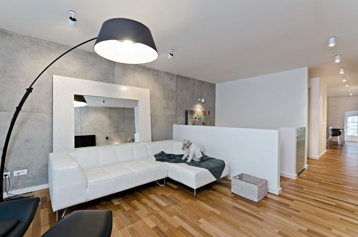 OOOOX | CORNLOFT - living room with mirror behind the sofa