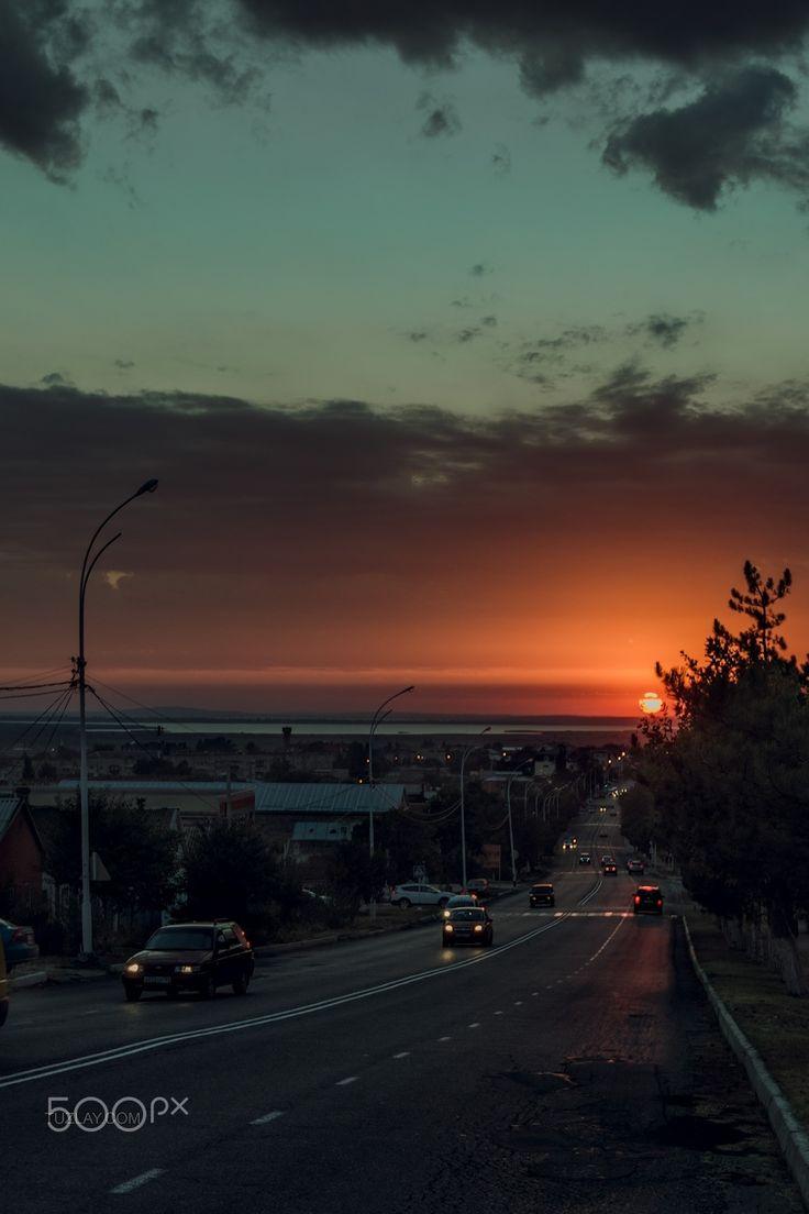 The course of the sunset - Temryuk city shot on Rosy Luksemburg street. Krasnodar region, Russia.