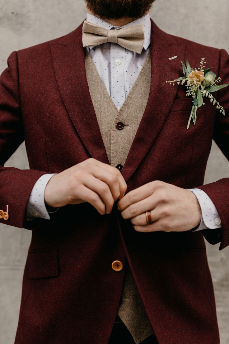 Burgundy red suit with wool texture and a tan vest with