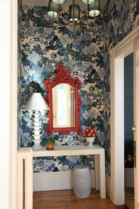 A bold wallpaper pattern in a space that can hold it is always magic!  Love this- and the pop of red- via Gorgeous Shiny Things