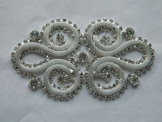 Don't like the beaded sash that came with my wedding dress... maybe use this rhinestone applique??