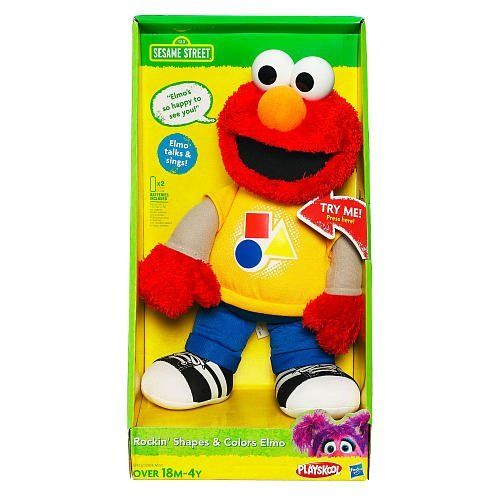 """Sesame Street Rockin' Shapes & Colors Elmo (Age: 18 months - 4 years) by Hasbro. $24.99. Learning is so much fun with the Sesame Street Rockin' Shapes & Colors Elmo! Give Elmo a squeeze to hear him talk and sing about his favorite things. Elmo sings all about colors and shapes! Figure comes with instructions. Includes 2 """"AA"""" batteries."""