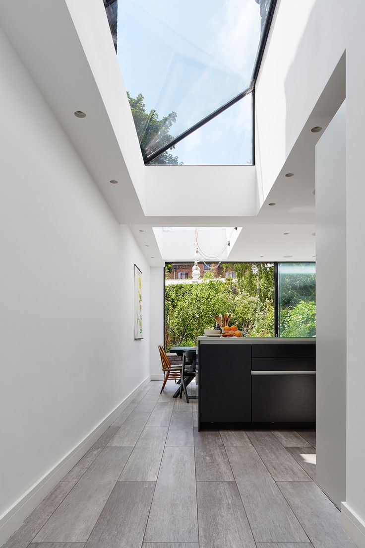 This Victorian Terraced property in Battersea has been reconfigured and remodelled throughout the ground floor. We demolished an existing rear and side extension, removing a tired kitchen and opened up the rear plan of this Victorian house. We rationalised the plan to create a modern practical family kitchen, dining and...