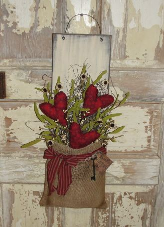 Primitive Heart Burlap Wall Board with Florals  Source: woodrufflesandlace.com