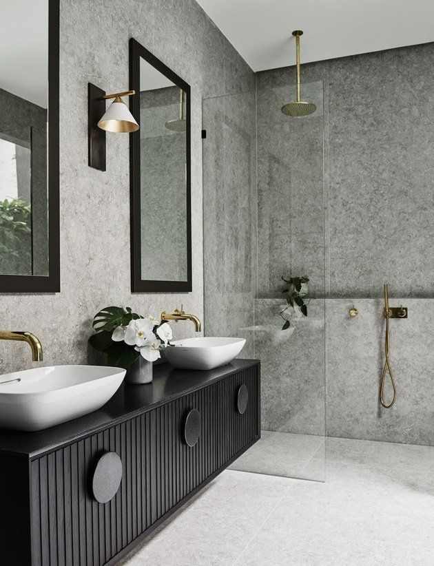 10 Stunning Stone Tile Bathroom Designs That Made Our Editors Do A Double Take Hunker Stone Tile Bathroom Bathroom Tile Designs Diy Bathroom Renovation Gorgeous black stone small bathroom