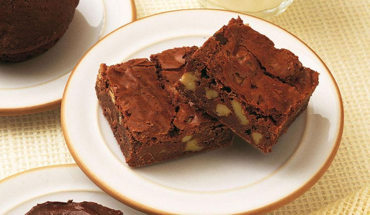 Makes 24 (336 cals each)Cook's tips: For brownies to be good they must not be overcooked. The secret is to take them out of the oven just before you think they are done – the middle should be soft and squidgy, not set firm. Don't worry if there is a dip in the middle and a crack on top, this is how it should be, and you will find the mixture firms up on cooling.Ingredients * 375g plain chocolate, broken into pieces * 250g baking margarine * 2 tsp instant coffee