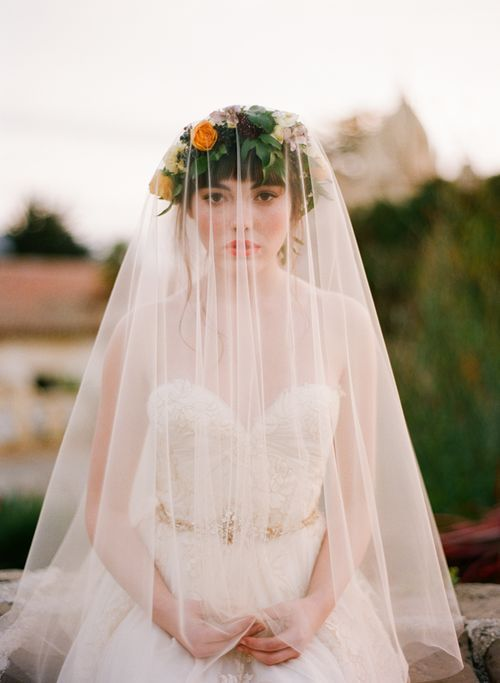 i adore the flower crown under the veil