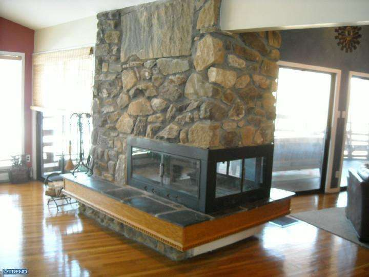 The 54 best images about mid century modern fireplaces on for Three way fireplace