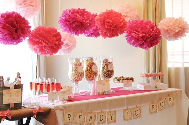 """""""Ready To Pop"""" shower.  Set up a popcorn bar, prepare champagne cocktails and of course, make pretty cake pops."""