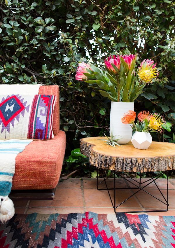 Colorful outdoors with fabrics and rugs!