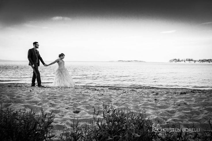 Black and white wedding portrait of bride and groom walking along the beach (Kristen Borelli Photography, Tigh Na Mara Wedding Photography, Tigh Na Mara Wedding Photography, Vancouver Island Wedding Photography, Parksville Wedding Photography, Wedding Photography in Victoria, Victoria Wedding Photographer, Nanaimo Wedding Photographer, Nanaimo Wedding Photography, Destination Wedding Photography, Destination Wedding Photographer)