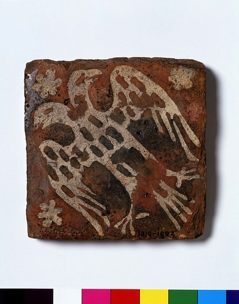 This 13th-century inlaid tile bears a double-headed eagle, the emblem of Henry III's brother, Richard of Cornwall. It was apparently found at a site in Lyme Regis. Tiles of the same design were used at Cleeve Abbey in Somerset, where a medieval tiled floor has survived almost intact at the site of the refectory. This heraldic design was among several first produced to commemorate the marriage in 1271 of Richard's son Edmund to Margaret de Clare.