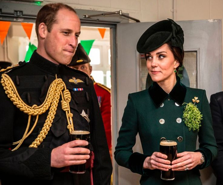 Britain's Prince William, Duke of Cambridge, (L) and his wife Britain's Catherine, Duchess of Cambridge react as they each hold a pint of Guinness whilst talking with off-duty soldiers from the 1st Battalion Irish Guards, after watching their annual St Patrick's Day parade at Cavalry Barracks in Hounslow, west London on March 17, 2017. / AFP PHOTO / POOL / RICHARD POHLE        (Photo credit should read RICHARD POHLE/AFP/Getty Images)