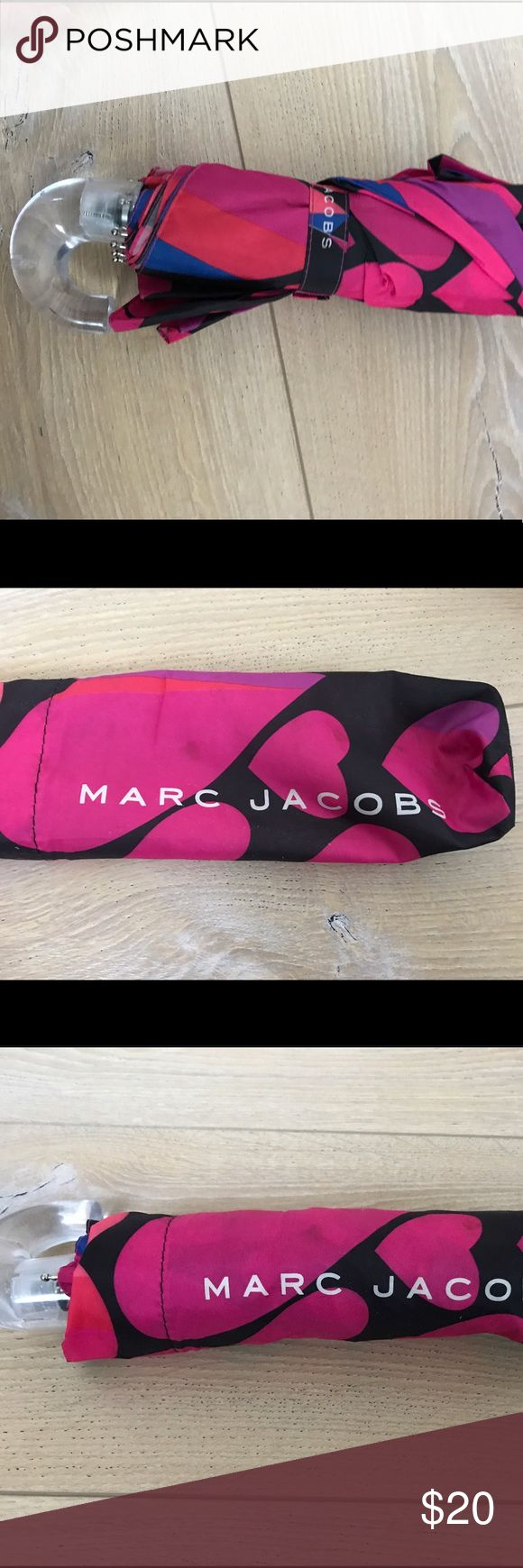 Marc by Marc Jacobs pink hearts small umbrella Preowned Marc by Marc Jacobs small umbrella with pink hearts and black background with some purple and blue.  Some small scratches on handle and bubbles... See pics   Umbrella length is 11 in from handle otherwise umbrella portion is 8 inches Marc By Marc Jacobs Accessories Umbrellas