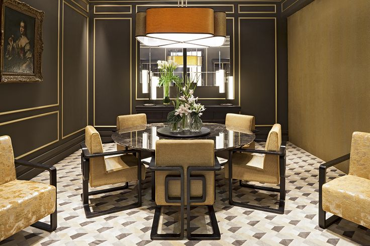 Golden and marble gala – Dining room  A triumph of golden fabrics, with a shiny marble table top that plays with the lacquered surfaces in the warm light. The interior design is precious, extremely refined, sophisticated and addresses to those who love classical yet timeless-elegance ambiances. The carpet in geometric patterns gives a trendy, decorative touch of modernity to the ambience.