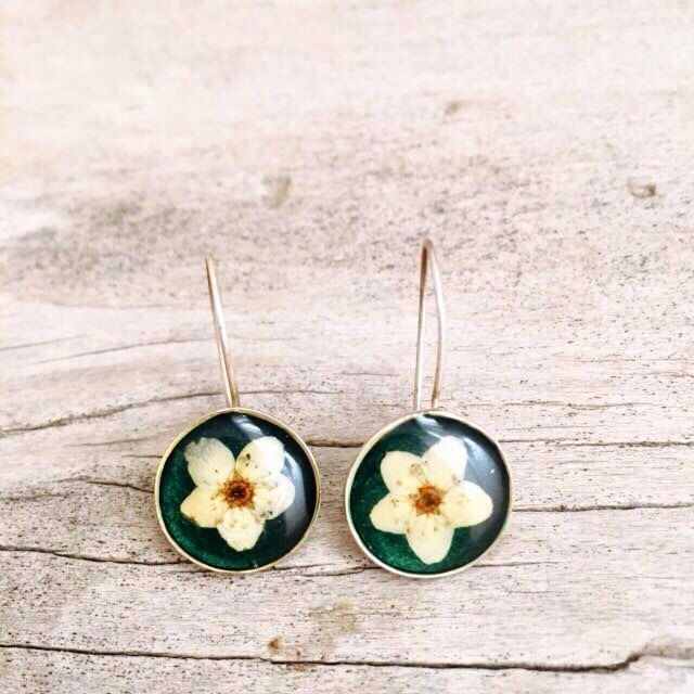 A personal favourite from my Etsy shop https://www.etsy.com/listing/267354455/pressflower-as-an-earing
