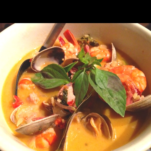 ... chili broth, scallops, tiger prawns, and Manila clams, topped with