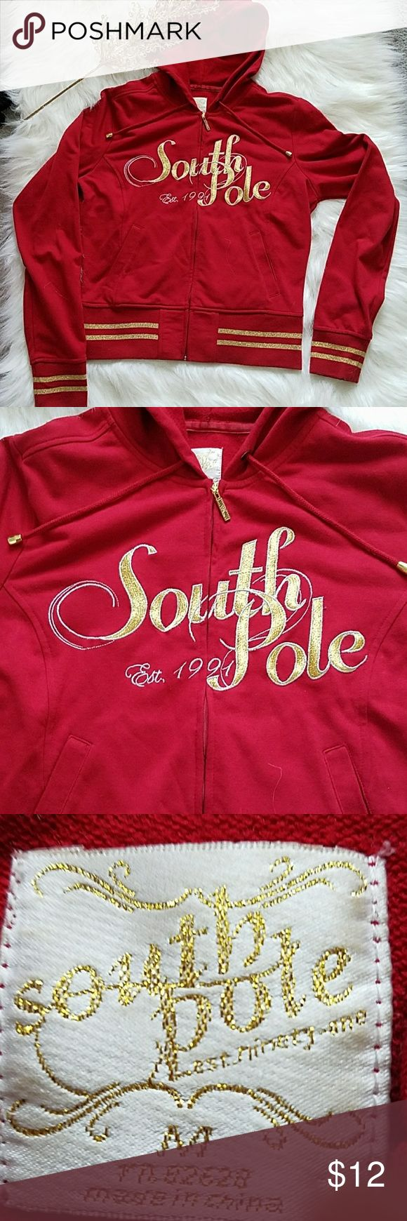 South Pole women girls red gold zip up jacket This is a South Pole women girls red and gold zip up jacket. It has drawstrings around the neck. It has two pockets in the front. It has a wonderful size hood on the back of it. The Hem of the sleeves fit the wrist comfortably snug. From the neck to the bottom Hem of this jacket is about 20 inches in length. This jacket is worn more for dressy fashion. South Pole Jackets & Coats