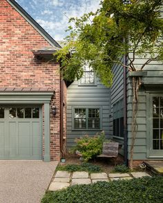 Good exterior wood color for red brick house - blue/green color and green landscaping, then add purple too