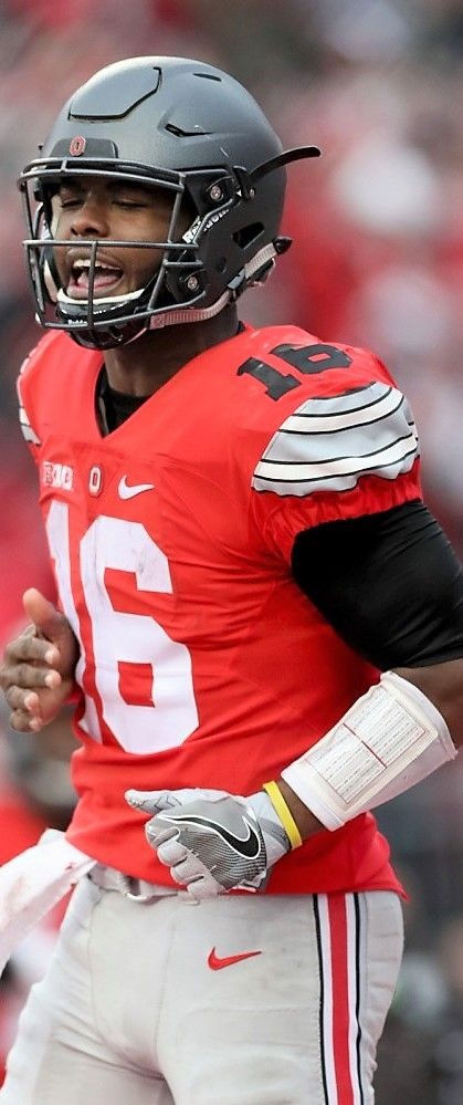 Ohio State Buckeyes quarterback J.T. Barrett (16) screams after scoring a touchdown in the first OT against Michigan