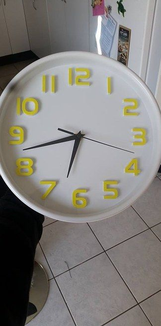 Paint a cheapo clock to make it pretty. That's smart.