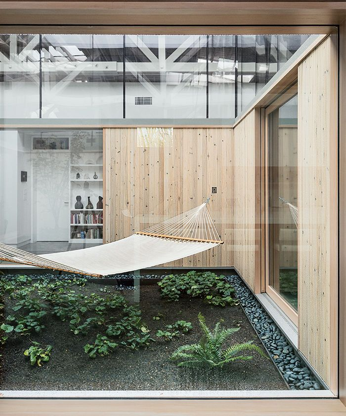 Portland renovated warehouse central atrium hammock. - having dirt and living plants in my house would be wonderful. I think I'd include a walkway, though. Miracle grow and nutrients would be a necessity