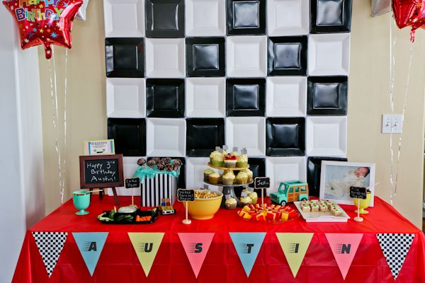 Boy's race car themed birthday party with paper plate backdrop.