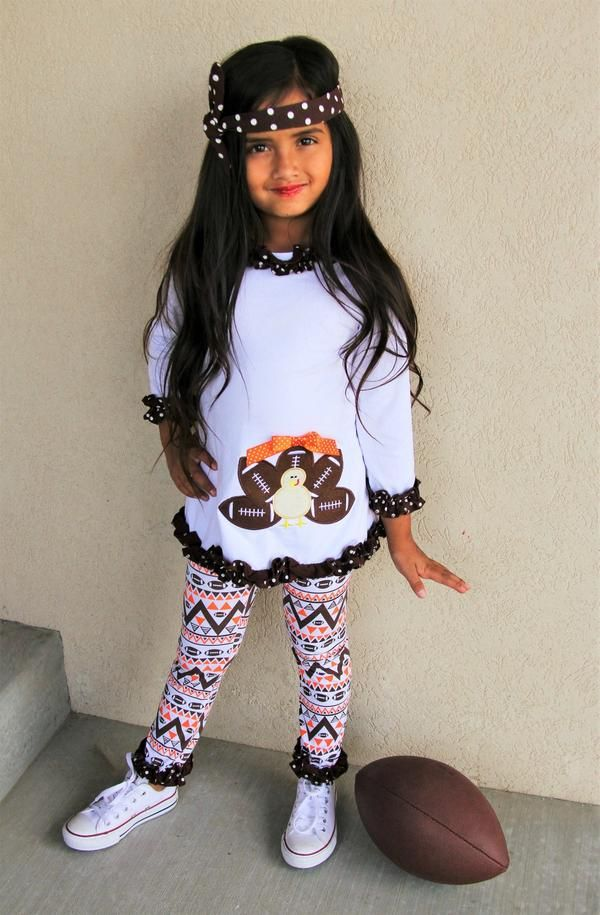This turkey football outfit has to be one of the most adorable outfits we have seen and a one of a kind! Adorable turkey with football feathers on the front pai