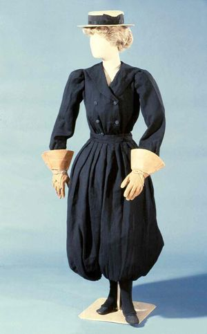 This rare wool bloomer bicycling outfit was probably handmade from a pattern about 1900. As shown here, a bicyclist would complete her outfit with gauntlet gloves and overgaiters to protect the legs.