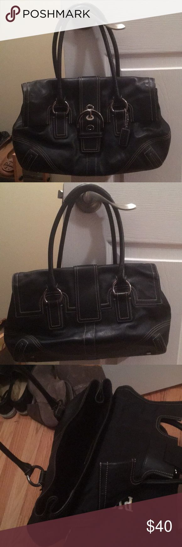 Black leather Coach purse This black leather Coach bag is perfect for an everyday bag. It has silver accents. The bag is used but it is in great condition. Coach Bags Shoulder Bags