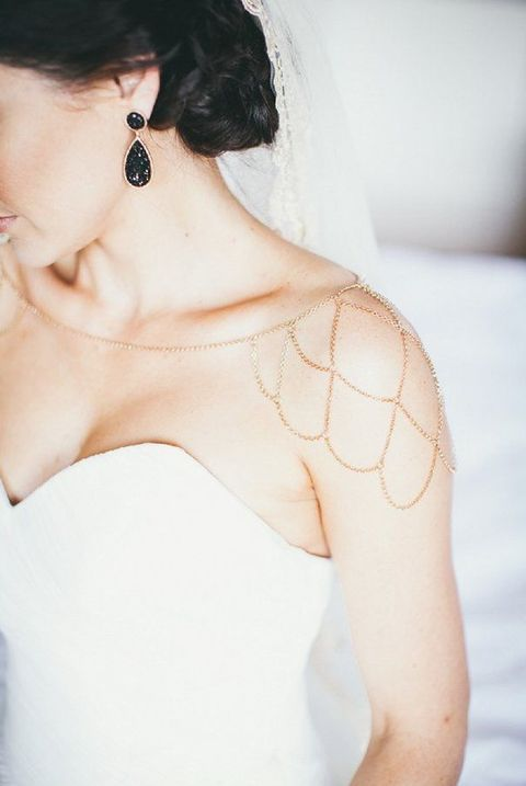 Elegant and cascading shoulder jewelry make this bride unique.
