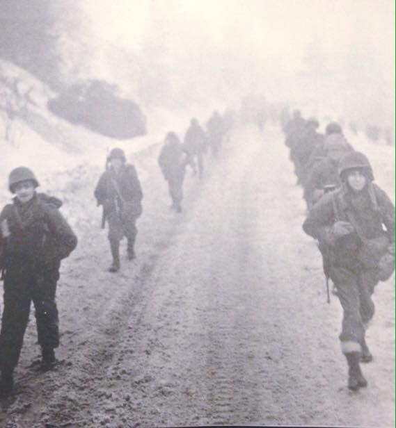 Riflemen of the 101st Airborne Division! Like always, two long, thin lines, as far as you can see, moving toward their new positions near Bastogne.