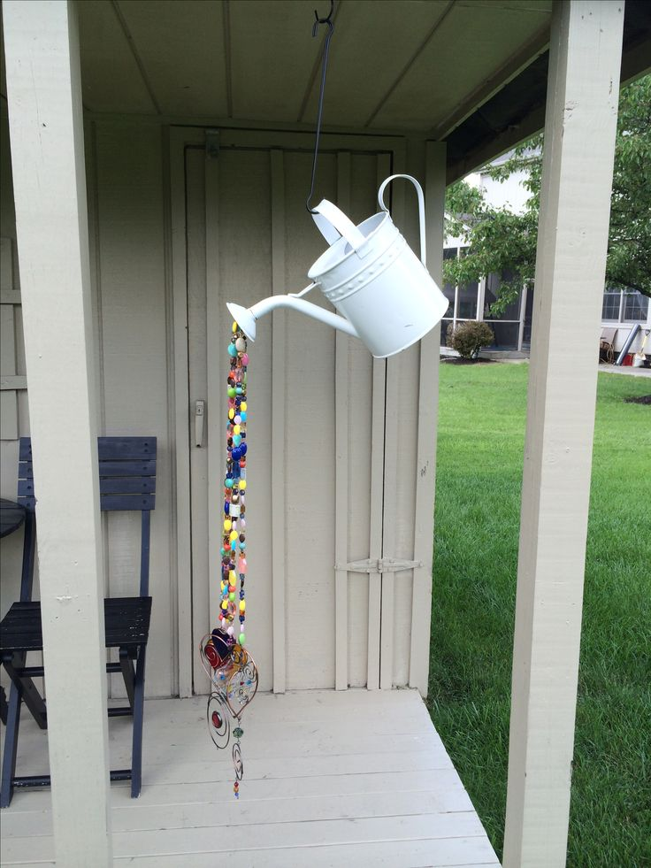 Homemade wind chime from watering can and beads- super easy!