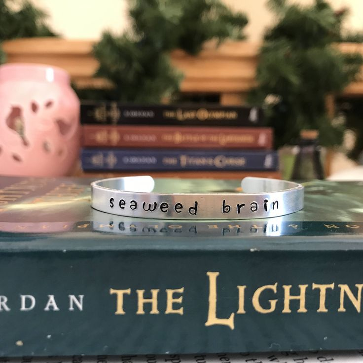 Percy Jackson Bangle, Metal Stamped Bangle, Olympians Bracelet, Seaweed Brain, Quote Bracelet, Book Lover, Bookworm, Book Gifts, Bookworm by BookishAdventures on Etsy https://www.etsy.com/listing/562961966/percy-jackson-bangle-metal-stamped