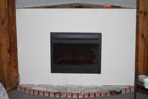 We had to remove an old wood stove and wanted a simple home renovation project that would add some ambiance to the room with minimal expense.  Our simple and inexpensive corner fireplace solution made a dramatic improvement.  See the before and after photos....